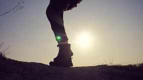 Teamwork business travel concept. Legs silhouette group hikers of people walking on the top of the mountain with stock footage