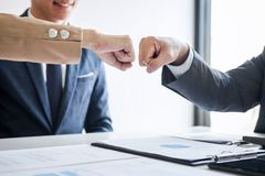 Teamwork of businessman partnership giving fist bump to greeting start up business strategy project royalty free stock photos