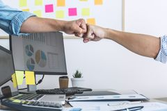 Teamwork of businesspeople partnership giving fist bump to greeting start up business strategy project royalty free stock photos