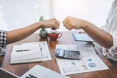 Teamwork of businesspeople partnership giving fist bump to greeting start up business strategy project royalty free stock photography