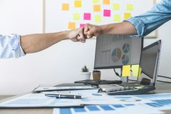 Teamwork of businesspeople partnership giving fist bump to greeting start up business strategy project stock photography