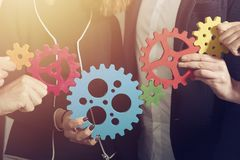 Business team connect pieces of gears. Teamwork, partnership and integration concept royalty free stock photos