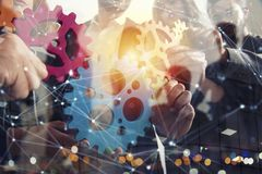 Business team connect pieces of gears. Teamwork, partnership and integration concept. Double exposure. Teamwork of businesspeople work together and combine royalty free stock photography