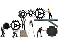 Teamwork of businesspeople. Teamwork works together to build a gear system Royalty Free Stock Photography