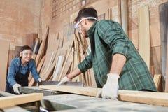 Teamwork at carpentry shop Royalty Free Stock Photo