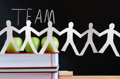 Teamwork and chalkboard Royalty Free Stock Image