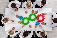 Teamwork with cogs of business Royalty Free Stock Photos