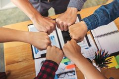 Teamwork of colleague assembly, Business team jointing putting f stock images