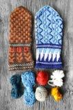 Teamwork colored yarn balls making mittens Royalty Free Stock Photo