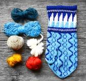 Teamwork colored yarn balls making mittens Royalty Free Stock Image