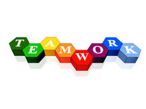 Teamwork in colour hexahedrons. 3d colour cubes hexahedrons with white letters - teamwork, word, text Royalty Free Stock Photography