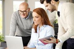 Teamwork with computer Royalty Free Stock Image