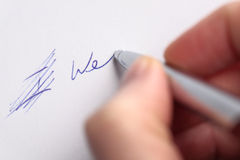Teamwork Concept. A hand edited the I and writing We on a piece of paper with a pen. A conceptual image about teamwork, teams, etc Royalty Free Stock Images