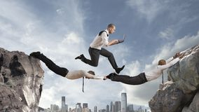 Teamwork concept. Concept of teamwork with two businessman like a bridge and a running businessmsn