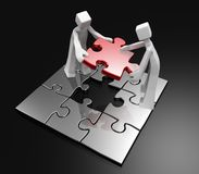 Teamwork concept. 3d mans working together to complete the last piece puzzle Royalty Free Stock Images