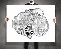 Teamwork concept on banner. Unrecognizable businessman showing banner with gears mechanism concept Stock Photos