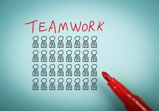 Teamwork concept. Is on blue paper with a red marker aside Royalty Free Stock Photography