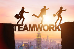The teamwork concept with business people crossing bridge Stock Images