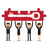 Teamwork concept. Business people holding puzzle success key. Royalty Free Stock Image
