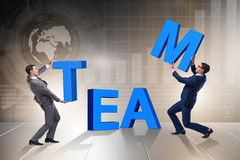 The teamwork concept with businessman putting letters Royalty Free Stock Photography
