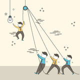 Teamwork concept: businessmen setting up a big lighting bulb in Royalty Free Stock Photo