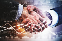 Teamwork concept. Businessmen shaking hands on forex chart background. Teamwork concept Royalty Free Stock Photos