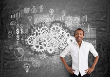 Teamwork concept with cheerful businessman. Teamwork concept with smiling african american businessman against chalkboard with gears and business chart sketch Stock Image