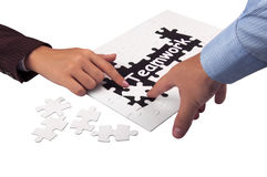 Teamwork concept. Closeup of hands and puzzle as teamwork concept Royalty Free Stock Images