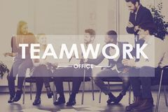 Teamwork concept. Colleagues having discussion in office royalty free stock image