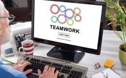 Teamwork concept on a computer. Man using a computer with teamwork concept on the screen stock image