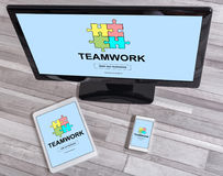 Teamwork concept on different devices royalty free stock photo
