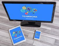 Teamwork concept on different devices. Teamwork concept shown on different information technology devices royalty free stock photography