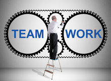 Teamwork concept drawn by a man on a ladder Royalty Free Stock Photography