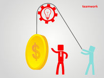 Teamwork concept - an employee raises a coin on a rope Stock Images