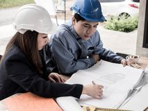 Teamwork concept, Engineer and workers discussing project of new building. ,Team of architects Asian people in group on. Construction site check documents and stock photo