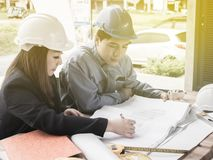 Teamwork concept, Engineer and workers discussing project of new building. ,Team of architects Asian people in group on. Construction site check documents and stock photos
