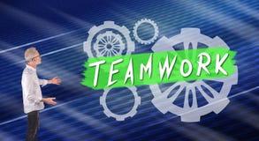 A teamwork concept explained by a businessman on a wall screen. Businessman showing a teamwork concept on a wall screen stock photo