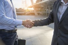 Teamwork concept. friendship business mans shaking hands together. success deal royalty free stock photo