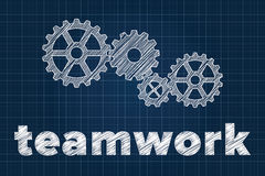 Teamwork concept with gears on blueprint Royalty Free Stock Photography