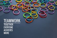 Teamwork concept. group of colorful rubber band on black background with word Teamwork, Together, Everyone, Achieves and More stock photography