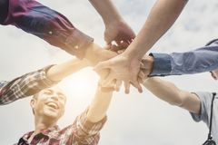 Teamwork concept, group of people put hand together.  royalty free stock image