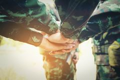 Teamwork Concept : Group of Soldier Hands Together Cross Process. Ing ready to fight Stock Photography