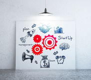 Teamwork concept. Interior with creative red cogwheel and pencil drawn business icons on whiteboard. Teamwork cocnept. 3D Rendering Royalty Free Stock Image