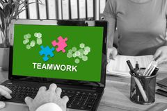 Teamwork concept on a laptop. Laptop screen with teamwork concept stock photography