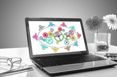 Teamwork concept on a laptop screen. Laptop screen showing teamwork concept royalty free stock photography