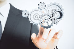 Teamwork concept with male hand putting on the the gears Royalty Free Stock Photo