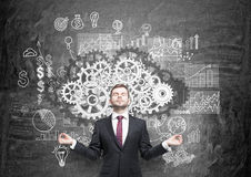 Teamwork concept with meditating businessman Royalty Free Stock Photo