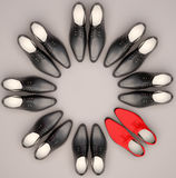 Teamwork concept. Men's shoes are located in the form of a circle. Stock Photos