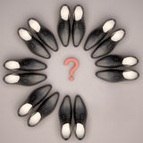Teamwork concept. Men's shoes are located in the form of a circle. Stock Photography