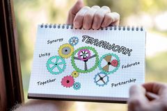 Teamwork concept on a notepad. Hand drawing teamwork concept on a notepad stock image